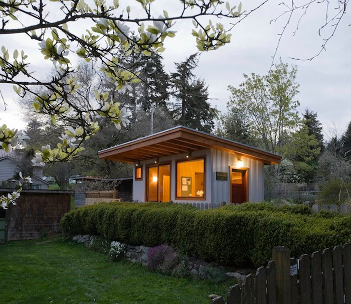 jetson green micro guest cottage with a green roof