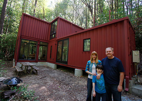 Jetson green shipping container cabin in the woods for How much does a 2 story house cost