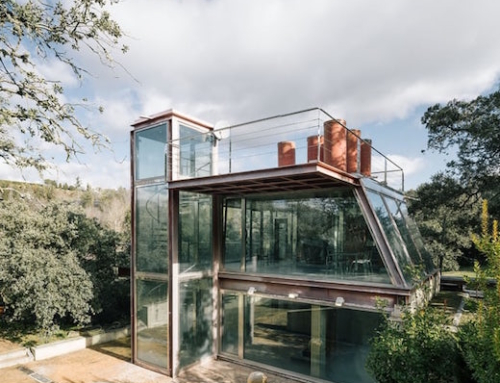 Metal and Glass House Deep in the Forest