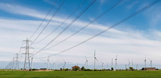 800px-Wind_Turbines_and_Power_Lines,_East_Sussex,_England_-_April_2009